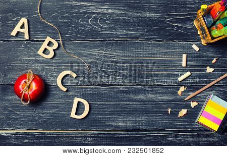 A Student's Desk On A School Board, A Dark Wooden Background Made Of Boards. Concept Of Education An