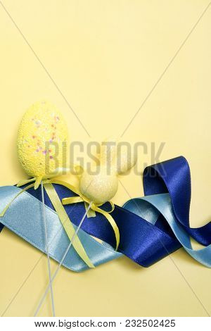 Easter decoration. Colored egg on a yellow background