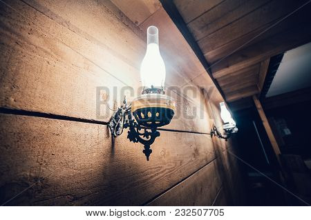 Old Vintage Electric Lamp On Wooden Wall