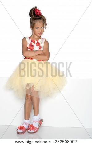 A Nice Little Girl Is Looking Because Of An Empty Banner In Which You Can Insert Any Text. The Conce