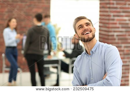 Cheerful man smiling  in office.