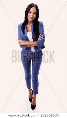 Full length portrait of a smiling businesswoman looking at camer