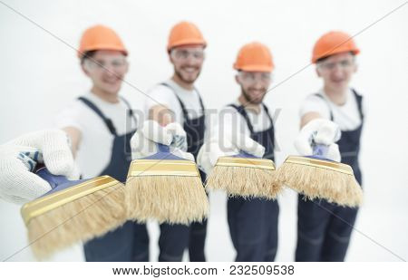 group of builders with different tools
