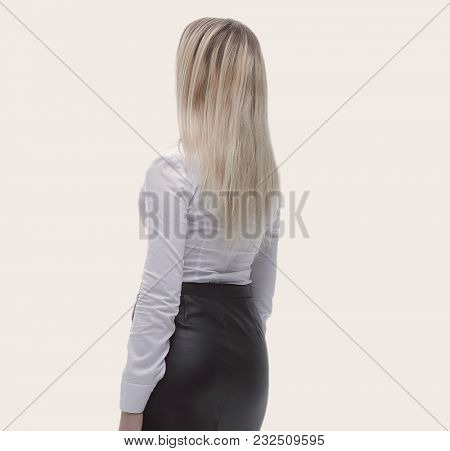 rear view.modern young business woman .