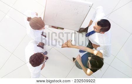 view from the top. the background image of a business handshake