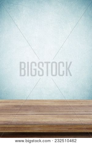 Empty Wooden Table Over Green Cement Wall  Background, For Product Display Montage