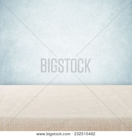 Empty Table With Linen Tablecloth Over Vintage Cement Wall Background, Product Display Montage
