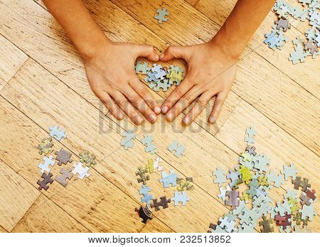 Little Kid Playing With Puzzles On Wooden Floor Together With Parent, Lifestyle People Concept, Lovi