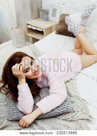 Young Pretty Brunette Woman In Her Bedroom Sitting At Window, Happy Smiling Lifestyle People Concept