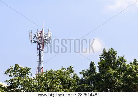 The Telecommunication Tower In Close-up Scene With The Blue Sky.