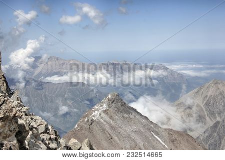 Wild Mountain Landscape. View From A Height. Sunny Summer Day. Everywhere There Are Mountain Ranges,