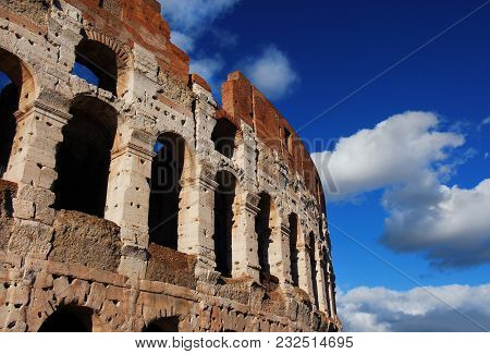 Coliseum Inner Ring Monumental Arcades With Blue Sky And Clouds In Rome