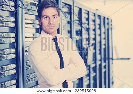 young handsome business man  engeneer in datacenter server room