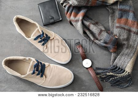 Composition with stylish men's  shoes on gray background