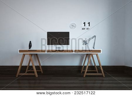 Neat workstation in a minimalist modern office with a desktop computer monitor on a trestle table style desk with drawers and an angle poise lamp. 3d rendering