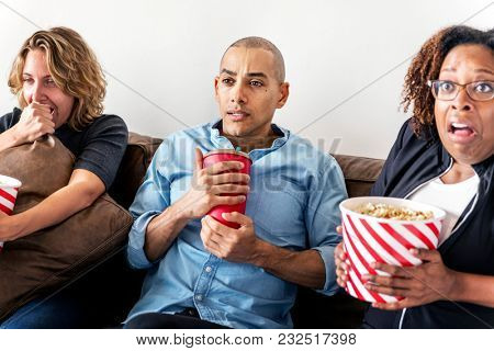 Group of friends watching a horror film