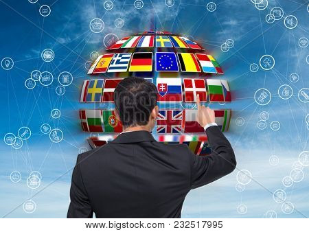 Digital composite of panel with flags on a ball and business man doing something on it