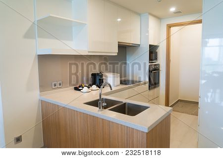 Kitchen Counter With Coffee Machine And Slow Cooker. Modern Convenient Kitchen With Sink, Built-in A