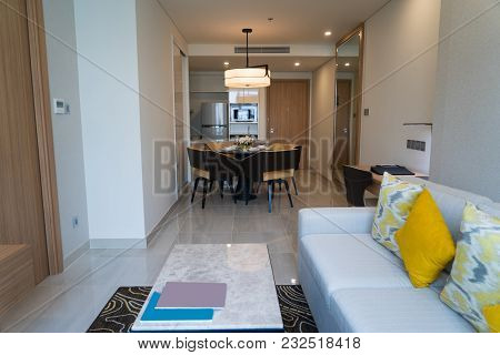 Narrow Studio Apartment With Fashioned Furniture. Modern Cozy Studio Flat With Coffee Table, Sofa An