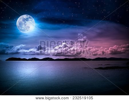 Beautiful Landscape View Of The Sea With Many Stars . Attractive Dark Sky With Cloud And  Full Moon