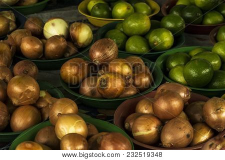 Onions And Lemons In Vessels To Be Sold In The Market