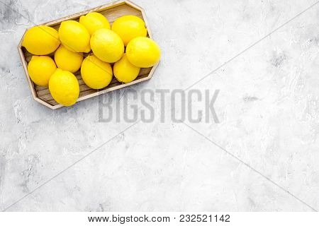 Ripe Lemon Fruit In Tray On Grey Background Top View.