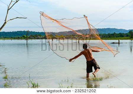 Chachoengsao, Thailand - December 8, 2011, Fisherman  Casting Traditional Fishing Net To Fish In Rur