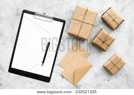 Parcels Box And Letters In Delivery Service Office On Stone Background Top View Space For Text
