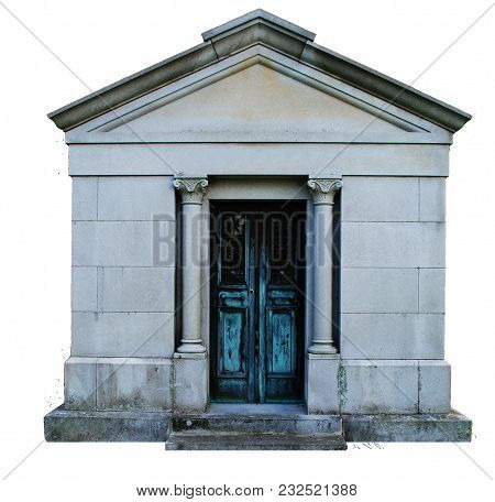 A Mausoleum With An Aged Aqua Door And Pillars, Showing Age.