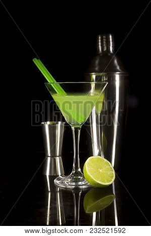 Cocktail And Bartender Tools On A Black Reflective Background