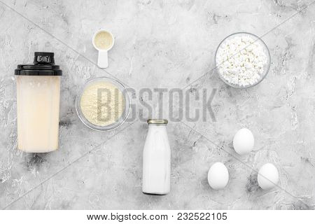 Sport Nutrition Set With Protein Powder For Cocktail, Eggs And Milk On Gray Stone Background Top Vie