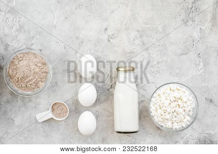 Protein Powder For Fitness Nutrition To Start Training And Eggs And Milk On Gray Desk Background Top