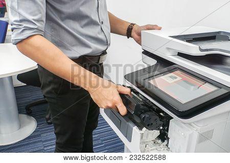 Close Up Businessman In Grey Shirt Put Ink Toner Cartridge Into Office Multifunction Printer For Pri