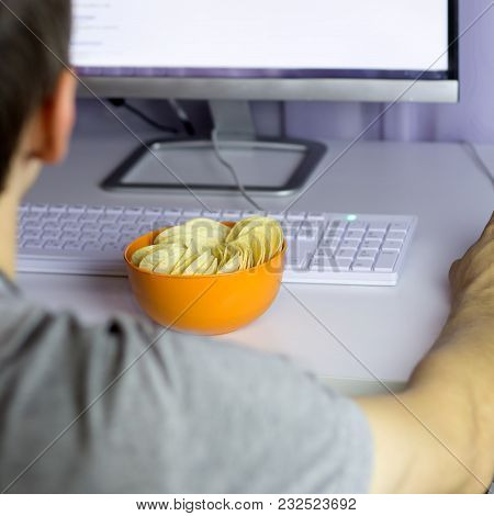 Unhealthy Eating Concept Eating Fast Food While Working With Computer