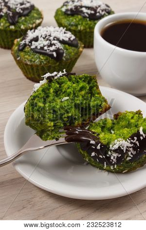 Homemade Muffins Baked With Wholemeal Flour With Spinach, Desiccated Coconut And Chocolate Glaze, Cu