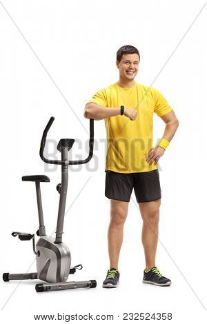 Full length portrait of a young man leaning on a stationary bike isolated on white background poster