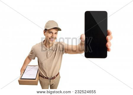 Delivery man showing a phone isolated on white background
