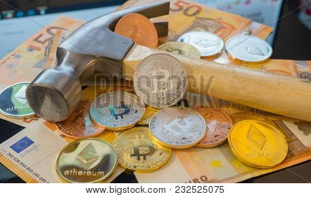 Market, Bitcoin mining or mine for bitcoin, compared to the traditional idea of physical mining with a pickaxe