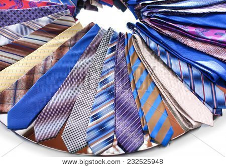 Classic neckties on shelf in boutique