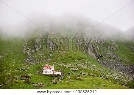 Lonely House In The Valley Fagaras Mountains, Transylvania, Romania, Europe. The Mountains Covered T