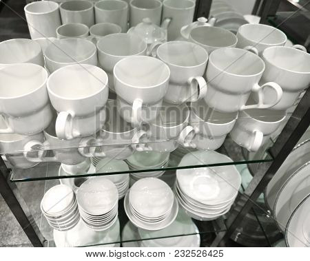 New Cups And Plates On A Shelf
