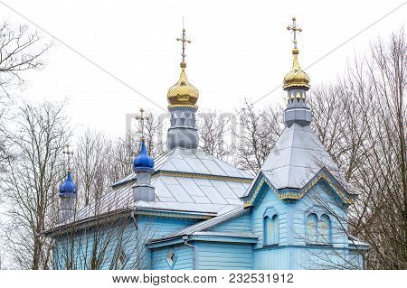 Wooden Blue Church. Beautiful Orthodox Blue Church Building In Ukraine In Early Spring