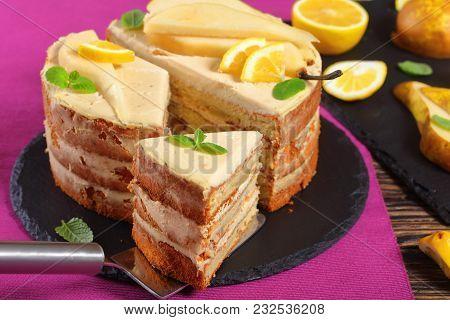 Close-up Of Sliced Pear Sponge Cake