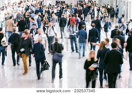 Large Crowd Of Blurred Business People