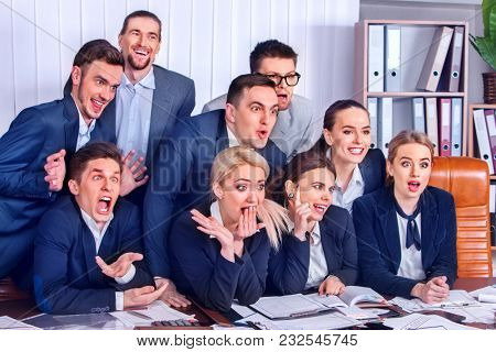 Mad business people office in high school celebrate successful passing exams. Employees scoff at boss. Men and women fooled to give bunny fingers prank. They make faces with joy.