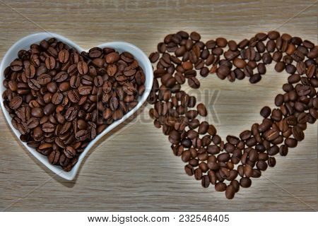 Heart, A Form Of Coffee Beans, And A Cup With Coffee Beans