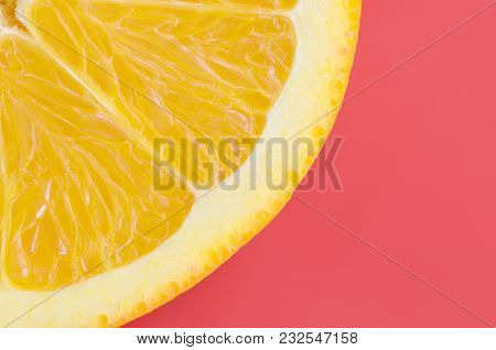 Top View Of A One Orange Fruit Slice On Bright Background In Red Color. A Saturated Citrus Texture I