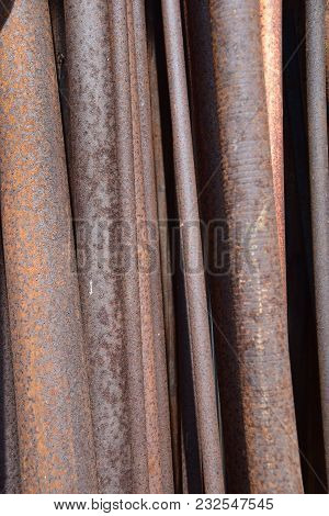 Old Iron Rods Rust, Lit By The Sunshine