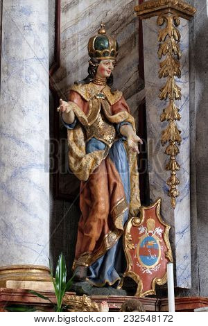 POKUPSKO, CROATIA - NOVEMBER 24: Statue of Saint Helena on the main altar in the Church of Assumption of the Virgin Mary in Pokupsko, Croatia, on November 24, 2016.