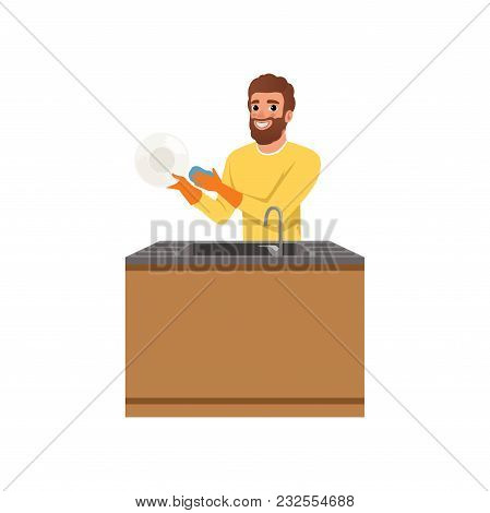 Bearded Guy In Orange Rubber Gloves Washing Plate With Sponge. Young Man Doing Household Chores. Cle